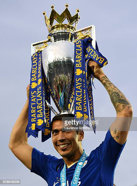 Leonardo Ulloa of Leicester City lifts the Premier League Trophy as players and staffs celebrate the season champions after the Barclays Premier...