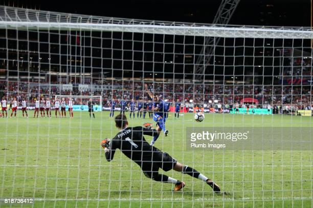 Leonardo Ulloa of Leicester City scores the first penalty during the Premier League Asia Trophy match between Leicester City and West Bromwich Albion...