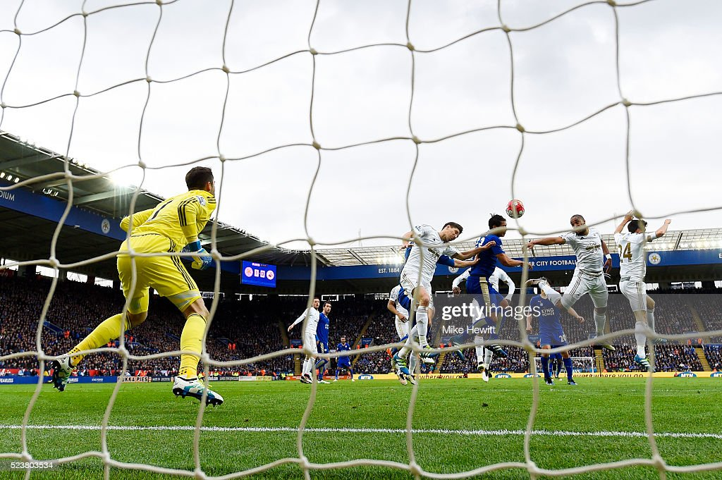 Leonardo Ulloa of Leicester City (3R) scores their second goal with a header past goalkeeper Lukasz Fabianski of Swansea City during the Barclays Premier League match between Leicester City and Swansea City at The King Power Stadium on April 24, 2016 in Leicester, United Kingdom.