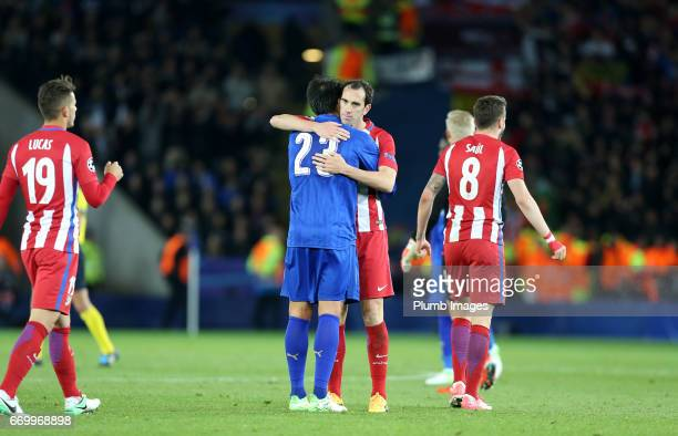 Leonardo Ulloa of Leicester City with Diego Godin of Atletico Madrid after the UEFA Champions League Quarter Final Second Leg match between Leicester...