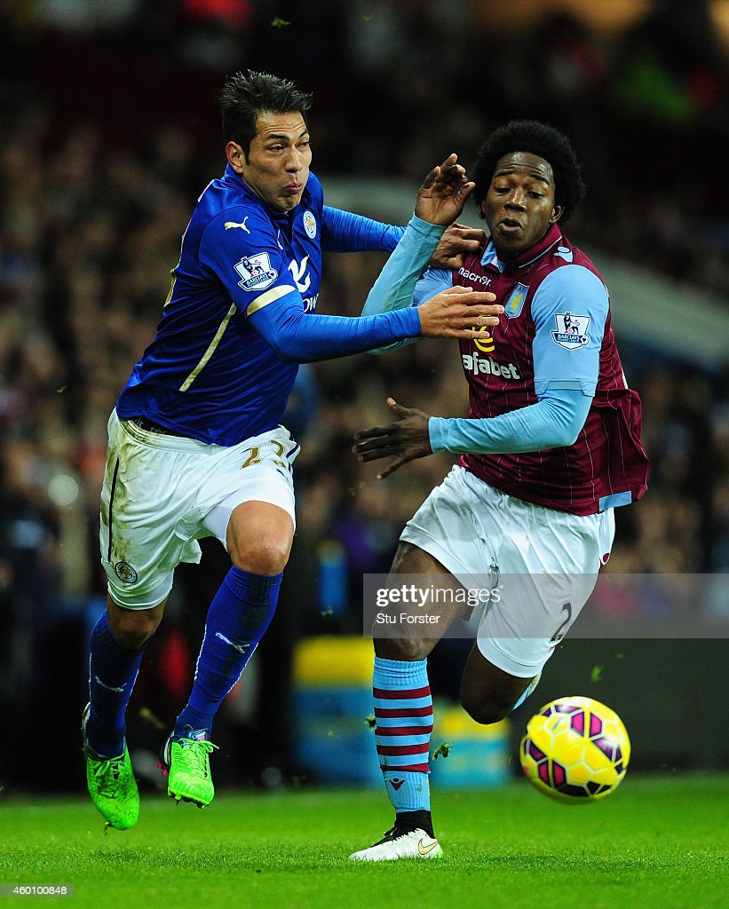Leonardo Ulloa of Leicester is challenged by Carlos Sanchez of Villa during the Barclays Premier League match between Aston Villa and Leicester City...