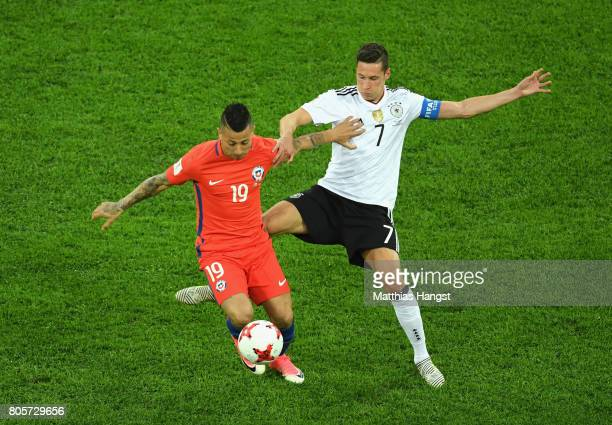 Leonardo Valencia of Chile and Julian Draxler of Germany battle for possession during the FIFA Confederations Cup Russia 2017 Final between Chile and...