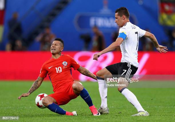 Leonardo Valencia of Chile and Julian Draxler of Germany compete for the ball during the FIFA Confederations Cup Russia 2017 Final between Chile and...