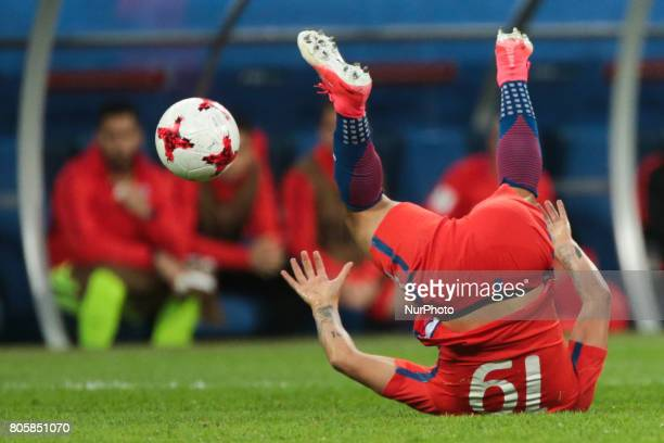 Leonardo Valencia of the Chile national football team vie for the ball during the 2017 FIFA Confederations Cup final match between Chile and Germany...
