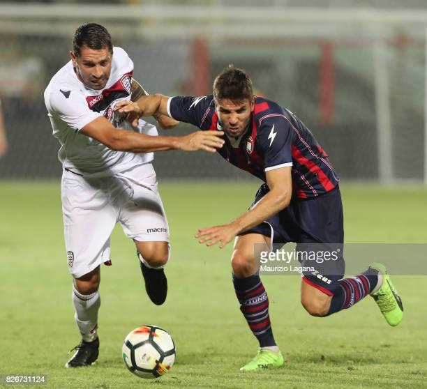 Leondro Cabrera of Crotone competes for the ball with Marco Borriello of Cagliari during the PreSeason Friendly match between FC Crotone and Cagliari...