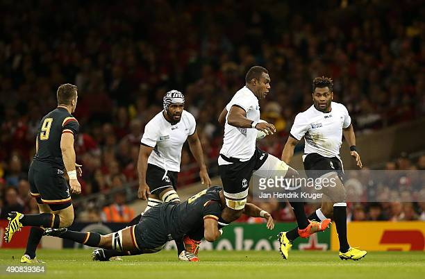 Leone Nakarawa of Fiji leaps through the tackle of Taulupe Faletau of Wales during the 2015 Rugby World Cup Pool A match between Wales and Fiji at...