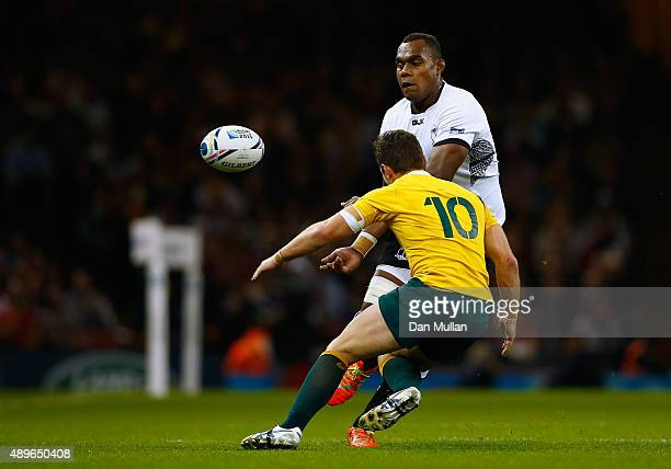Leone Nakarawa of Fiji passes the ball under pressure from Bernard Foley of Australia during the 2015 Rugby World Cup Pool A match between Australia...