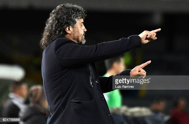 Leonel Alvarez coach Independiente Medellín gives instructions to his players during a match between Millonarios and Independiente Medellin as part...