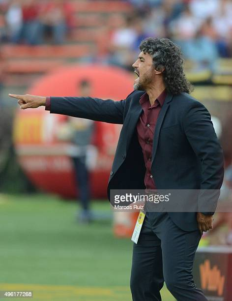 Leonel Alvarez coach of Independiente Medellin gives instructions to his players during a match between Independiente Medellin and Millonarios as...