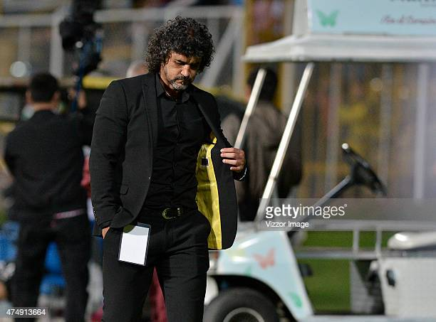 Leonel Alvarez coach of Independiente Medellin leaves the field during halftime during a first leg semifinal match between Deportes Tolima and...