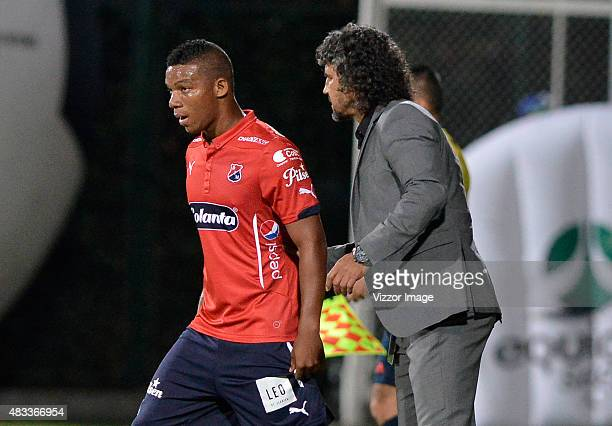Leonel Alvarez coach of Independiente Santa Fe gives instructions to Frank Fabra during a match between La Equidad and Independiente Medellin as part...
