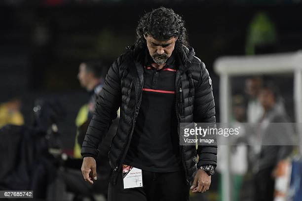Leonel Alvarez coach of Medellin looks dejected during the quarterfinals second leg match between Independiente Santa Fe and Independiente Medellin...