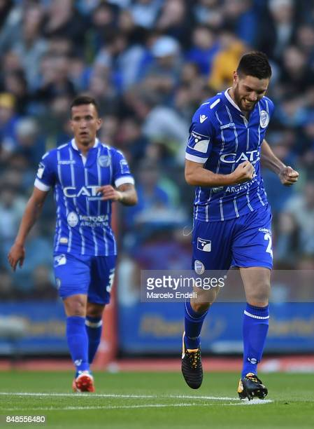 Leonel Galeano of Godoy Cruz celebrates with teammates after scoring the first goal of his team during a match between Boca Juniors and Godoy Cruz as...