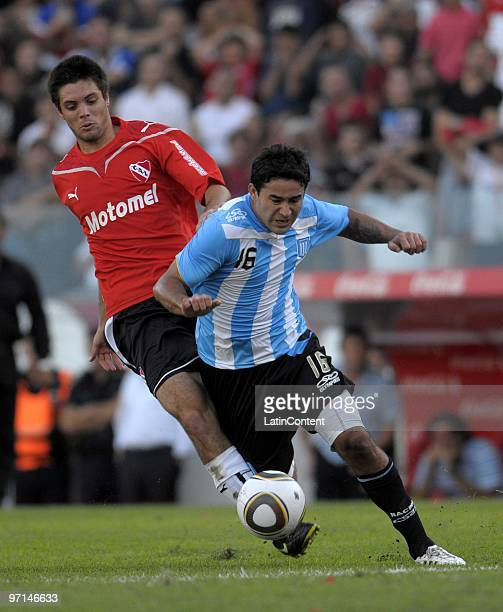 Leonel Galeano of Independiente vies for the ball with Claudio Bieler of Racing during their match as part of the Clausura 2010 on February 27 2010...