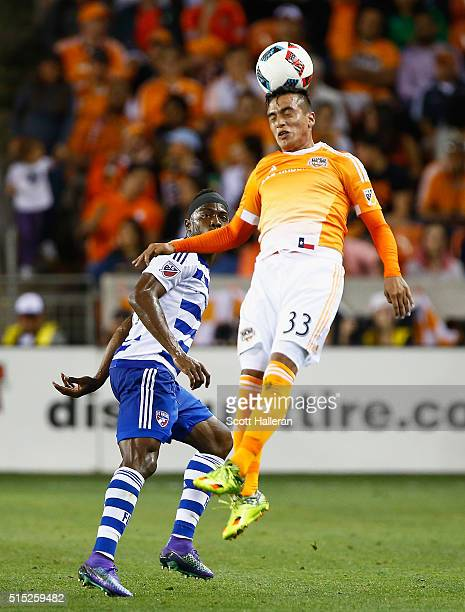Leonel Miranda of the Houston Dynamo battles for the ball with Maynor Figueroa of FC Dallas during their game at BBVA Compass Stadium on March 12...