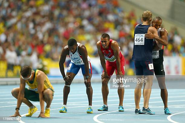 Leonel Suarez of Cuba and overall winner and gold medalist Ashton Eaton of the United States rest after the Men's Decathlon 1500 metres during Day...