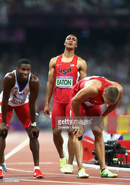 Leonel Suarez of Cuba Ashton Eaton of the United States and Trey Hardee of the United States react after competing in the Men's Decathlon 1500m on...