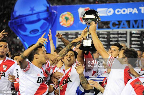Leonel Vangioni Leonardo Pisculichi and German Pezzella of River Plate lift the Copa Sudamericana trophy after winning a second leg final match...