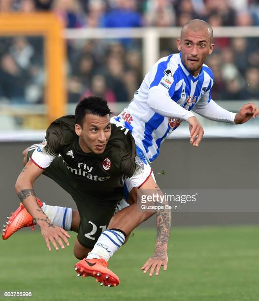 Leonel Vangioni of AC Milan and Ahmad Benali of Pescara Calcio in action during the Serie A match between Pescara Calcio and AC Milan at Adriatico...