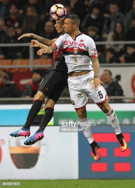 Leonel Vangioni of AC Milan competes for the ball with Armando Izzo of Genoa CFC during the Serie A match between AC Milan and Genoa CFC at Stadio...