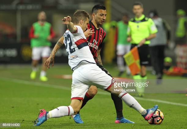 Leonel Vangioni of AC Milan competes for the ball with Darko Lazovic of Genoa CFC during the Serie A match between AC Milan and Genoa CFC at Stadio...