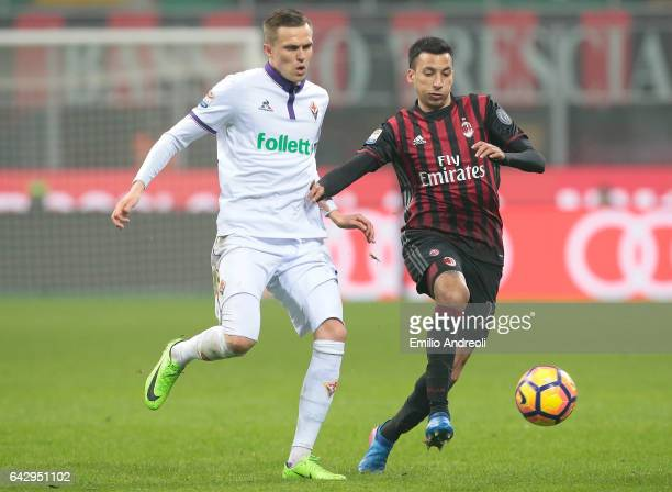 Leonel Vangioni of AC Milan is challenged by Josip Ilicic of ACF Fiorentina during the Serie A match between AC Milan and ACF Fiorentina at Stadio...