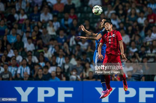Leonel Vangioni of Argentina competes for the ball with Chi Ho Lee of Hong Kong during the HKFA Centennial Celebration Match between Hong Kong and...