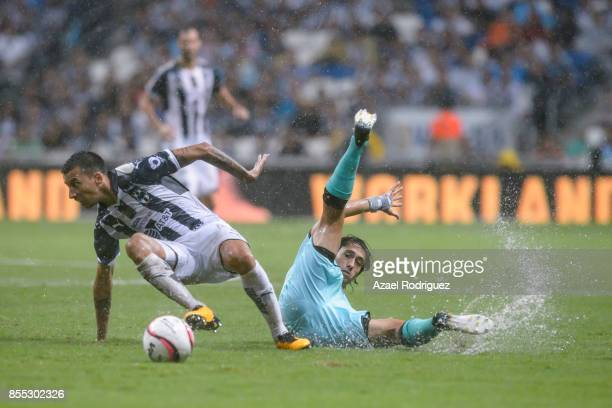 Leonel Vangioni of Monterrey fights for the ball with Jose Abella of Santos during the 11th round match between Monterrey and Santos Laguna as part...