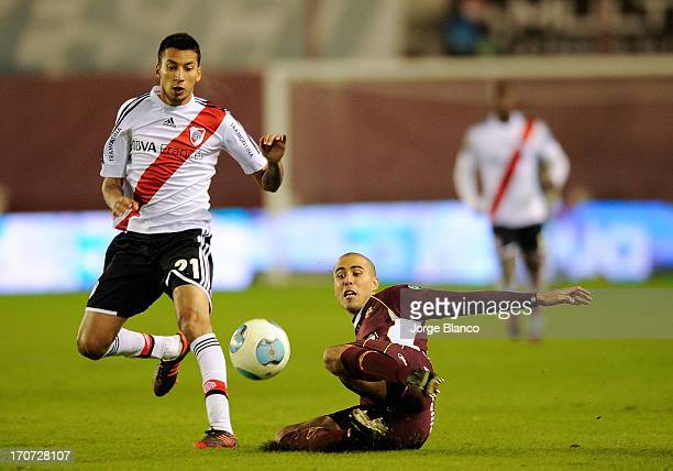 Leonel Vangioni of River Plate and Guido Pizarro of Lanus fights for the ball during a match between Lanus and River Plate as part of the 18th round...