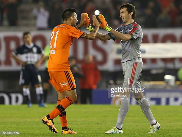 Leonel Vangioni of River Plate and Marcelo Barovero of River Plate greet each other during a match between River Plate and Gimnasia y Esgrima La...