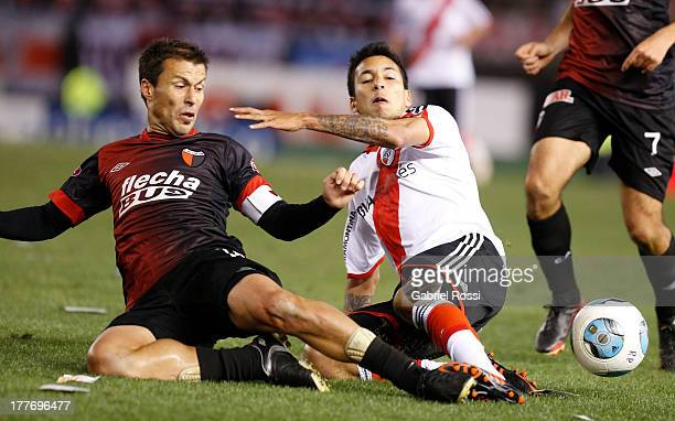 Leonel Vangioni of River Plate fights for the ball with Bruno Urribarri of Colon de Santa Fe during a match between River Plate and Colon de Santa Fe...