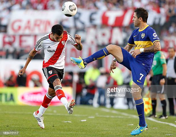 Leonel Vangioni of River Plate fights for the ball with Juan Martinez of Boca Juniors during a match between River Plate and Boca Juniors as part of...
