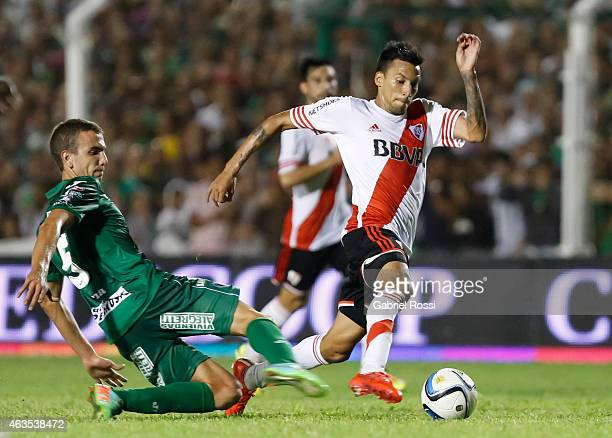 Leonel Vangioni of River Plate fights for the ball with Renzo Spinacci of Sarmiento during a match between Sarmiento and River Plate as part of first...
