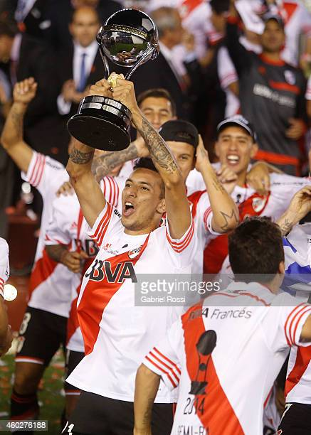 Leonel Vangioni of River Plate lifts the trophy after wining the second leg final match between River Plate and Atletico Nacional as part of Copa...