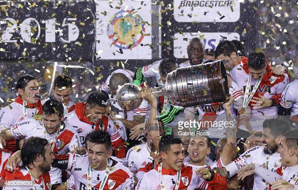 Leonel Vangioni of River Plate lifts the trophy after winning a final match between River Plate and Tigres UANL as part of Copa Bridgestone...