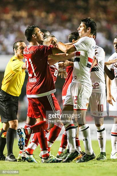 Leonel Vangioni of River Plate scuffles with Jonathan Calleri Sao Paulo scoring the second goal of his team during a match between Sao Paulo and...