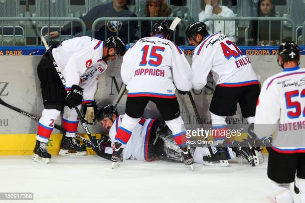 Leonhard Pfoederl of Ice Tigers celebrates his team's first goal with team mates during the DEL match between Adler Mannheim and Thomas Sabo Ice...