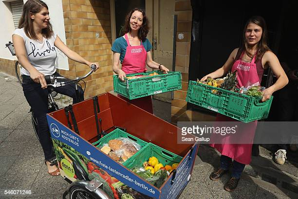 Leoni Beckmann cofounder of the restaurant 'Restlos Gluecklich' looks on as members of her team unload a new batch of groceries from a nearby organic...