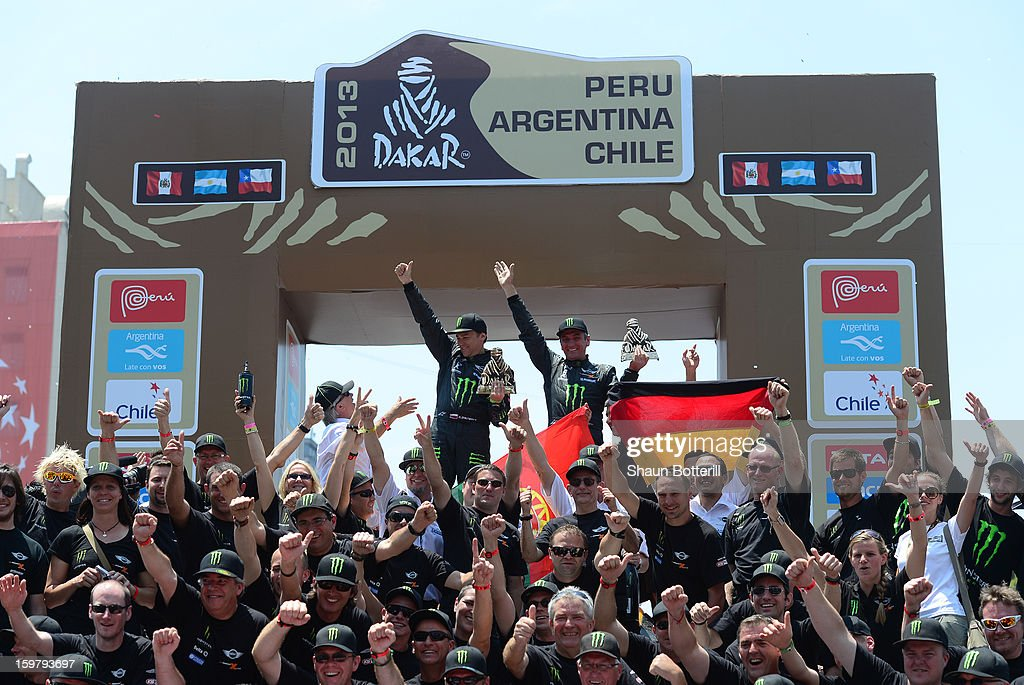 Leonid Novitskiy and co-driver Konstantin Zhiltsov of team Mini, 3rd place in Autos, celebrate during the podium presentations at the end of the 2013 Dakar Rally on January 20, 2013 in Santiago, Chile.