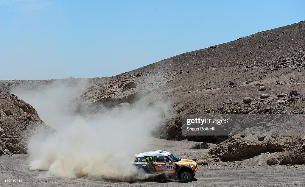 Leonid Novitskiy and co-pilot Konstantin Zhiltsov of team Mini compete in stage 5 from Arequipa to Arica during the 2013 Dakar Rally on January 9, 2013 in Arequipa, Peru.