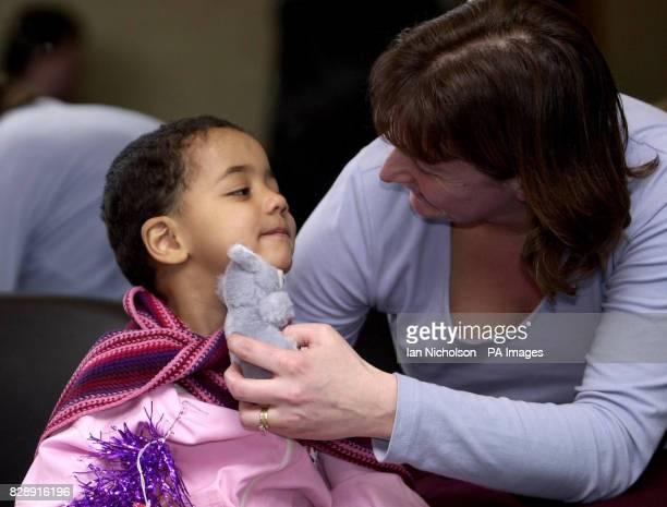 Leonid one of the children at the Zuzino street shelter in Moscow receives a visit from aid worker Sharon Hedges from Leamington Spa Warwickshire on...