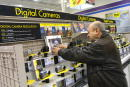 Leonid Rogachevsky shops in the digital camera department at a Best Buy store January 11 2002 in Niles IL The Minneapolisbased consumer electronics...