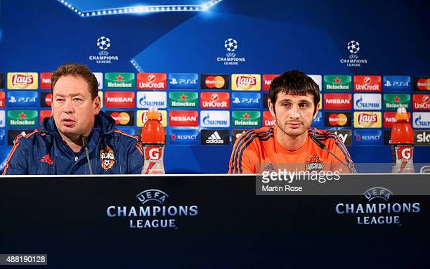 Leonid Slutski head coach of Moscow and Alan Dzagoev attend the press conference ahead of the UEFA Champions League group B match between VfL...