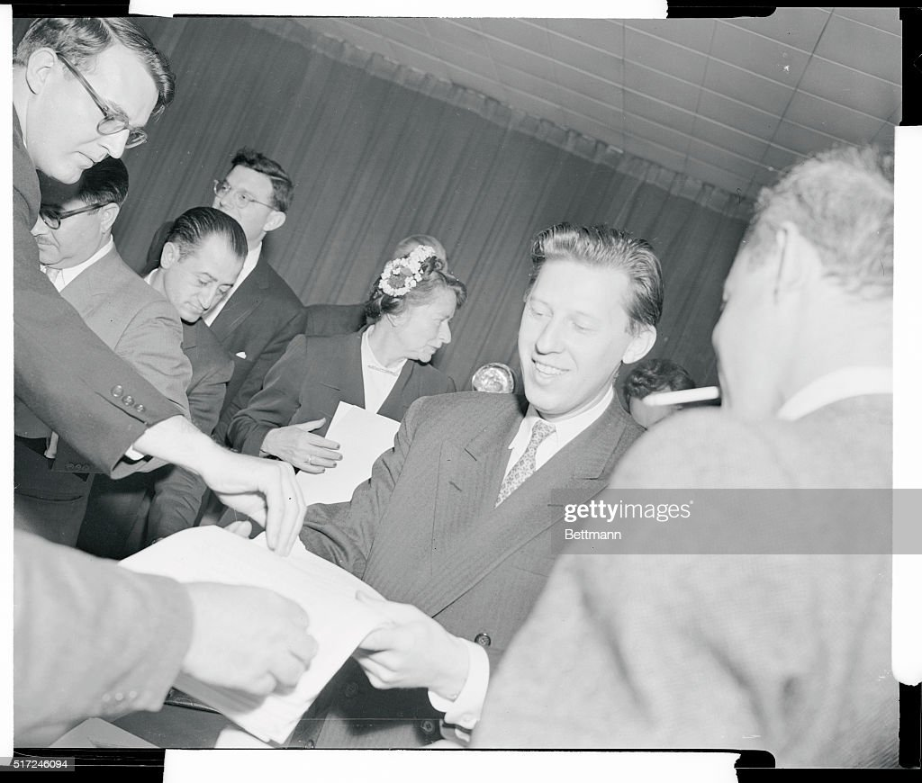 Leonid Zamyatin smiles as he hands out a statement to reporters at a press conference April 26 at the United Press Conference April 26 at the United...