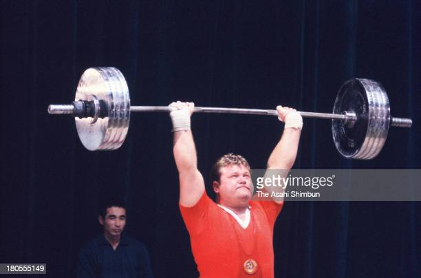 Leonid Zhabotynskiy of Soviet Union competes in the Men's Weightlifting Heavyweight during the Tokyo Olympics at Shibuya Kokaido Hall on October 18...