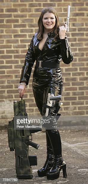 Leonie Ashfield from Christie's auctioneers poses with prop guns during promotion of a sale of weaponry from James Bond films on November 2 2006 in...