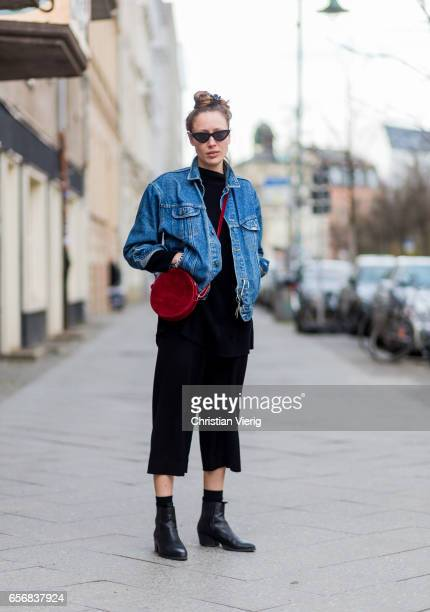 Leonie Bockelmann wearing black cropped pants denim jacket red bag ankle boots on March 22 2017 in Berlin Germany