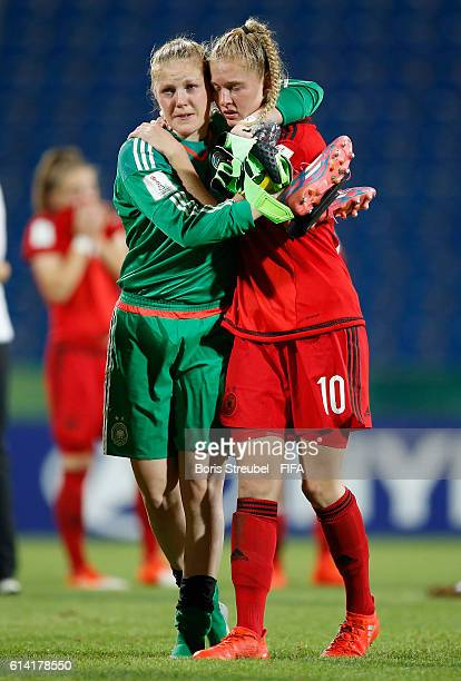 Leonie Doege of Germany and team mate Janina Minge show their frustration after losing the FIFA U17 Women's World Cup Quarter Final match between...