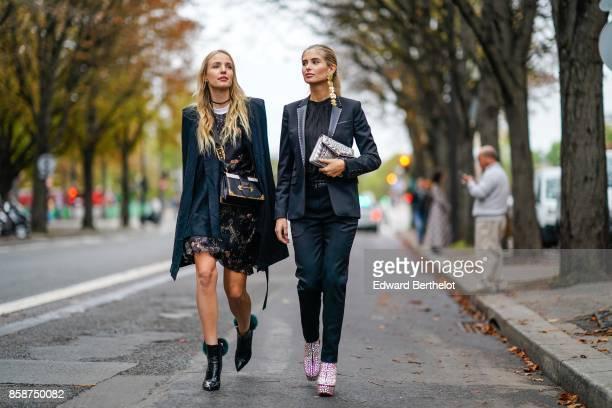 Leonie Hanne and Xenia Van Der Woodsen outside John Galliano during Paris Fashion Week Womenswear Spring/Summer 2018 on October 1 2017 in Paris France