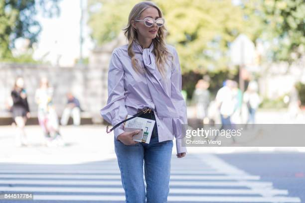 Leonie Hanne wearing a knotted blouse denim jeans seen in the streets of Manhattan outside Tory Burch during New York Fashion Week on September 8...